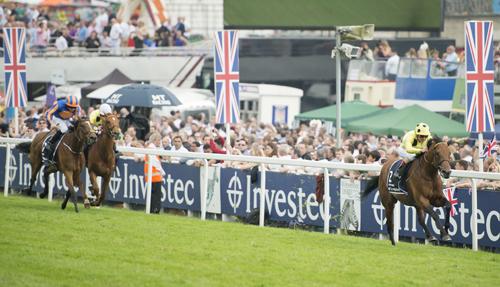 Postponed (Andrea Atzeni) wins the QEII Coronation Cup Epsom 4.6.16 Pic: Edward Whitaker