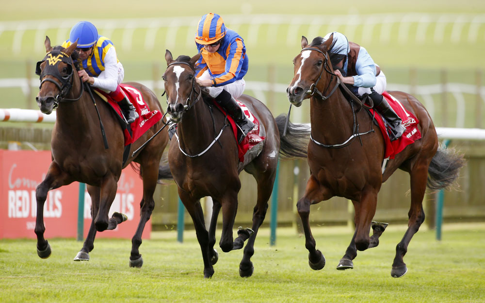 "Brave Anna and Seamie Heffernan (light blue cap) winning The Connolly's Red Mills Cheveley Park Stakes from Roly Poly (orange) and Lady Aurelia (left) Newmarket 24.9.16 Pic Dan Abraham-racingfotos.com  THIS IMAGE IS SOURCED FROM AND MUST BE BYLINED ""RACINGFOTOS.COM"""
